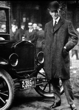 Henry Ford next to Ford car